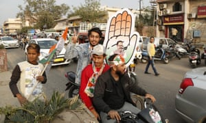 Congress party supporters celebrate the party's victory in the Rajasthan state assembly elections in Jaipur.