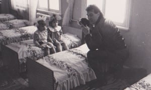 John Downing photographing Chernobyl children at a nearby hospital in the early 1990s. In 1992 Downing was honoured with an MBE for services to journalism