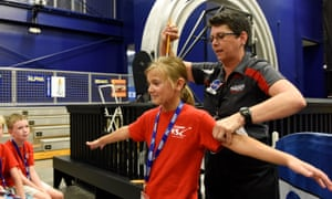 Camper Danica Linforth, 8, gets ready to spin under a pencil held by educator Dee Maynard during Camp KSC at the U.S. Astronaut Hall of Fame, Kennedy Space Center Visitor Complex on July 23, 2015. Photo by Todd Anderson Instagram - TODD389 Twitter - @ta1dxjd