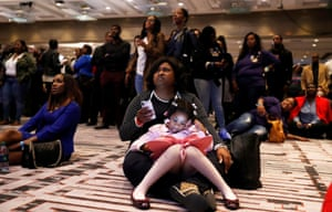 Deidre Brown Collins holds her daughter, Vitalia Collins, as they watch returns during a midterm election night party for Georgia Democratic gubernatorial nominee Stacey Abrams in Atlanta, Georgia, U.S.