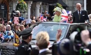 Britain's Queen Elizabeth II accompanied by Prince Philip, Duke of Edinburgh greet wellwishers during a walkabout in Windsor