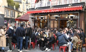 Customers sit on outside terraces in Paris as cafes, restaurants, and other businesses re-open.