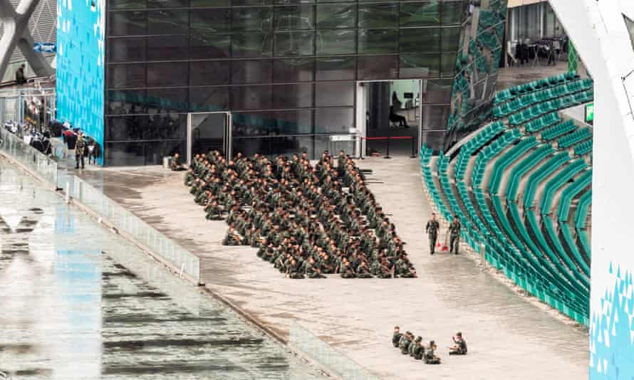 People's Armed Police officers in the Shenzhen Bay sports centre.