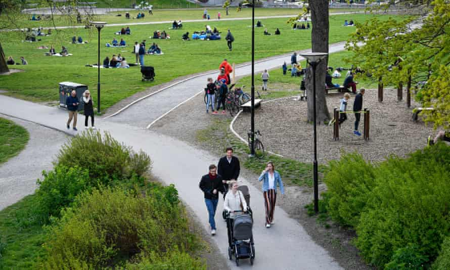 People enjoy a warm spring day in Ralambshovsparken park, Stockholm, 8 May.