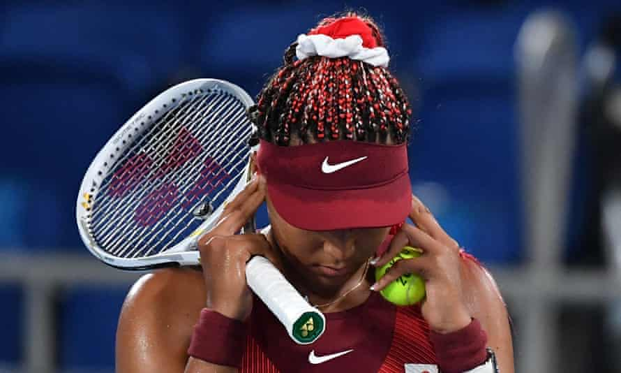 Naomi Osaka attempts to compose herself during her third-round defeat against Marketa Vondrousova at Ariake Tennis Park.