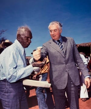 Vincent Lingiari, left, an Elder of the Gurindji people of the Northern Territory, receiving a handful of soil from prime minister Gough Whitlam during a ceremony to mark the historic return of land rights to Indigenous people.