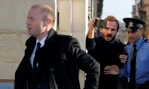 Malta's prime minister Joseph Muscat arrives to meet members of the EU fact-finding mission at his office in Valletta.