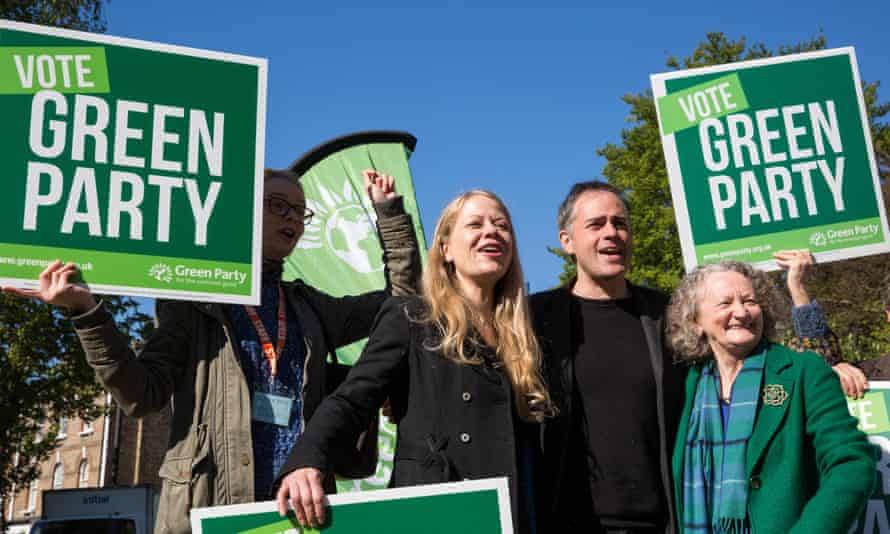 Siân Berry, Jonathan Bartley and Jenny Jones with placards reading 'Vote Green party'