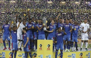 Furman (No 8) and Sipho Mbule lift the MTN 8 trophy after SuperSport United defeated Highlands Park in last year's final