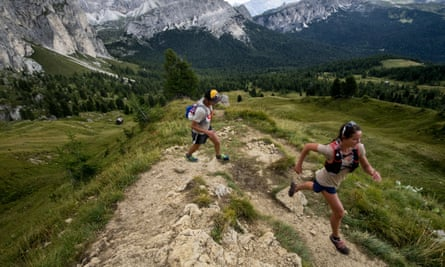 Two people running in the Italian Dolomites