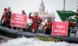 Greenpeace activists hold banners during a protest next to Statoil's Songa Enabler oil rig in the Barents sea, Norway, July 2017