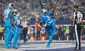 Carolina Panthers quarterback Cam Newton throws a few shapes after scoring  a touchdown. b2ada1efb