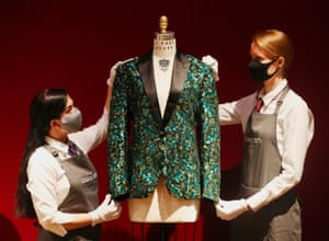 London, England Gallery assistants handle an oak leaf Glamouflage jacket made for Mick Jagger, one of the items from the archive of fashion designer L'Wren Scott to be offered at auction at Christie's