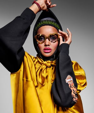 My story isn't just: 'I grew up in a refugee camp': Halima Aden wears hoodie by rokit.co.uk; dress by Ssōne, matchesfashion.com; glasses by francisdelara.com; and bag strap, worn as a headband, bottletop.com.