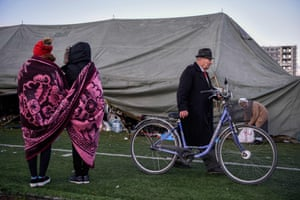 A makeshift camp at the local football stadium after the strongest earthquake in decades has left many people homeless