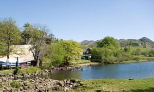 Canoes on Llynnau Mymbyr at Plas y Brenin