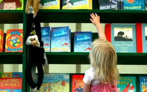 A young reader reaching up for a book at the Cheltenham literary festival in 2005.