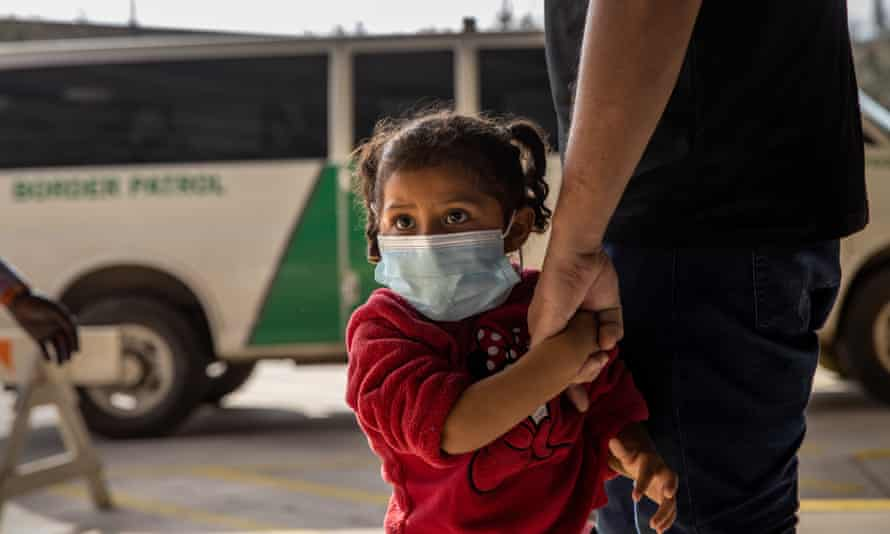 A young asylum seeker arrives with her family at a bus station after being released by US border patrol in Brownsville, Texas, on 25 February.