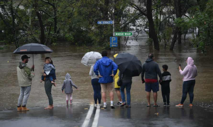 Onlookers watch the submerged New Windsor Bridge at Windsor in Sydney's north-west.