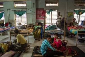 Indian families rest in a ward reserved for women recovering from caesarean sections, at Tezpur Civil hospital. Assam has the highest rate of maternal mortality in India. Many public medical facilities are overcrowded and unhygienic, suffer from a chronic shortage of doctors and often have patients sprawled on floors and in hallways.