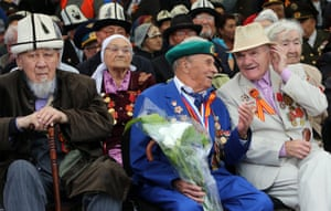 Veterans in traditional and modern dress attend the celebrations in Bishkek, Kyrgyzstan