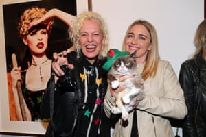 Ellen von Unwerth with Grumpy cat and her owner, Tabatha Bundesen, during the opening night of the photographer's exhibition at Taschen Gallery in Los Angeles, California