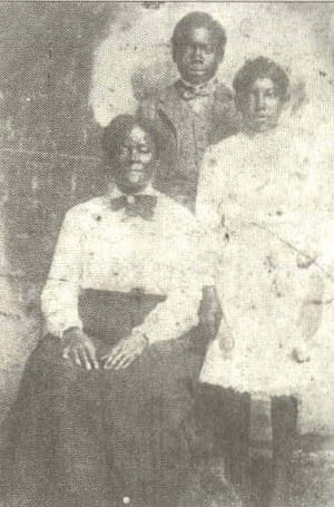 Sarah Carrier, left, Sylvester, standing and Willie Carrier, right.