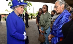 The Queen meets members of the community affected by the fire at Grenfell Tower in west London during a visit to the Westway sports centre