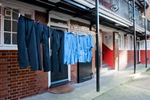 Kings College hospital scrubs hung out to dry on an estate near Waterloo in London