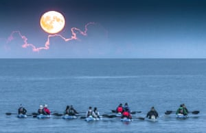 Fountainstown, Cork, Ireland. 13th October, 2019. Night Kayakers take to the water and observe the hunters Moon rising at Fountainstown, Co. Cork, Ireland. Credit; David Creedon / Alamy Live News2A4CXKR Fountainstown, Cork, Ireland. 13th October, 2019. Night Kayakers take to the water and observe the hunters Moon rising at Fountainstown, Co. Cork, Ireland. Credit; David Creedon / Alamy Live News