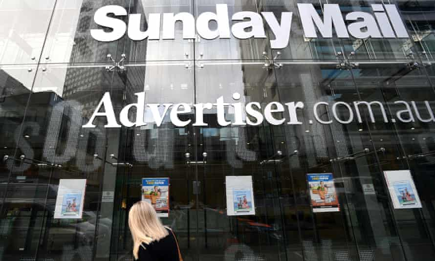 exterior of News Corp building with advertiser and sunday mail signs