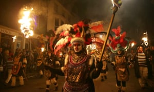 Revellers dressed as zulu warriors parade through the streets of Lewes.