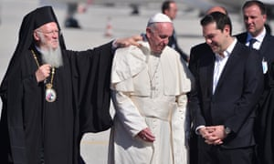 Archbishop Bartholomew I of Constantinople adjusts Pope Francis's collar upon his arrival