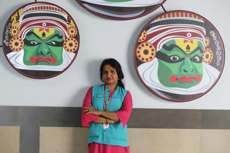 Transgender Kothi Metro employee Karthika, 33, poses at Changampuzha Park metro station