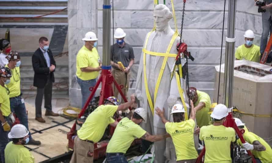 Workers prepare to remove the Jefferson Davis statue Saturda from the Kentucky capitol in Frankfort.