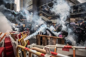Protesters wearing gas masks react after the police fired teargas during an anti-government rally in Tsuen Wan, Hong Kong.