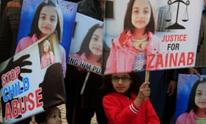 A girl holds a sign as she chants slogans with others to condemn the rape and killing of seven-year-old Zainab Ansari.