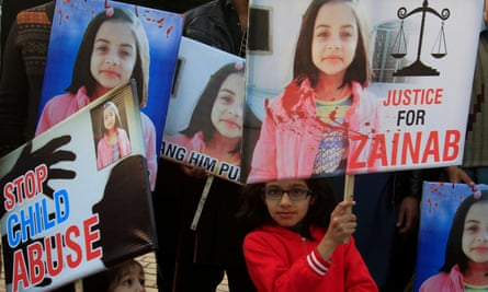 Girls hold placards at a protest in Lahore against the rape and murder of Zainab Ansari.