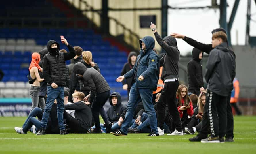 Oldham supporters halt the game at home to Barrow this month by invading the pitch.