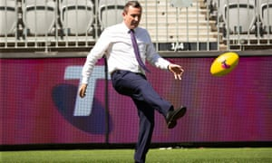 WA premier Mark McGowan has a kick at Optus Stadium on Thursday ahead of the AFL grand final.