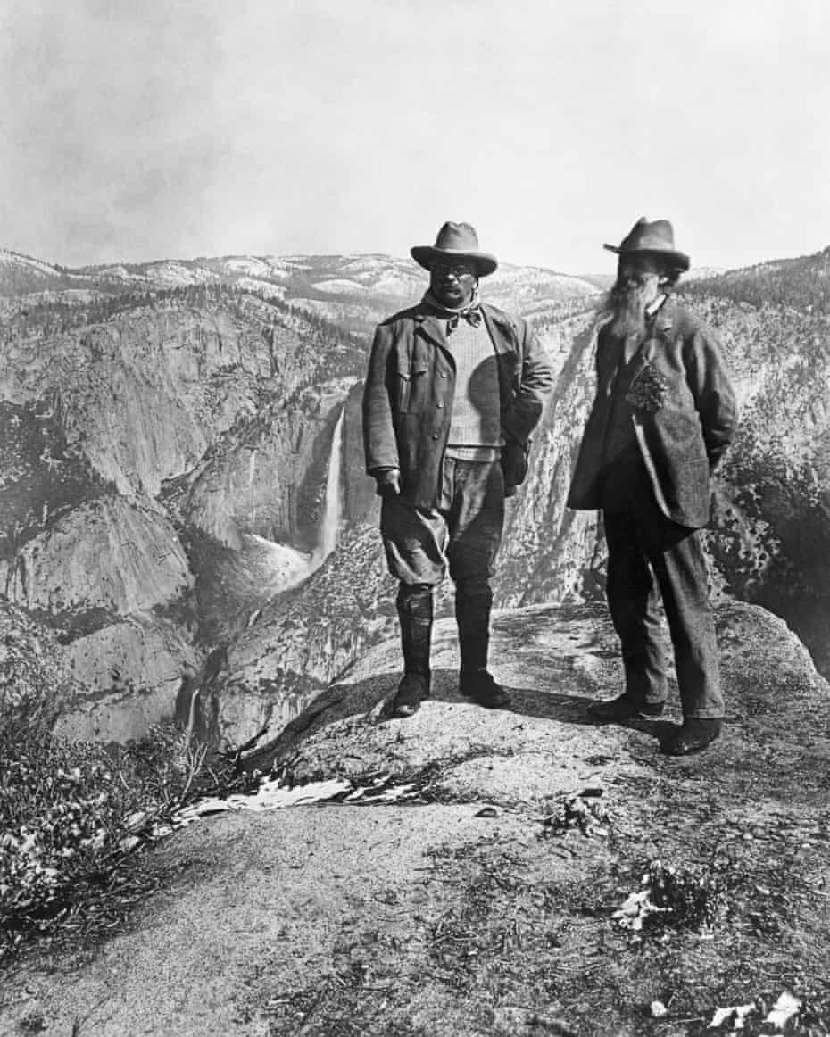 Theodore Roosevelt stands with naturalist John Muir on Glacier Point, above Yosemite Valley in California.