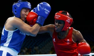 Nicola Adams lands a crushing blow to Sarah Ourahmoune's head on her way to another Olympic gold medal for Great Britain.