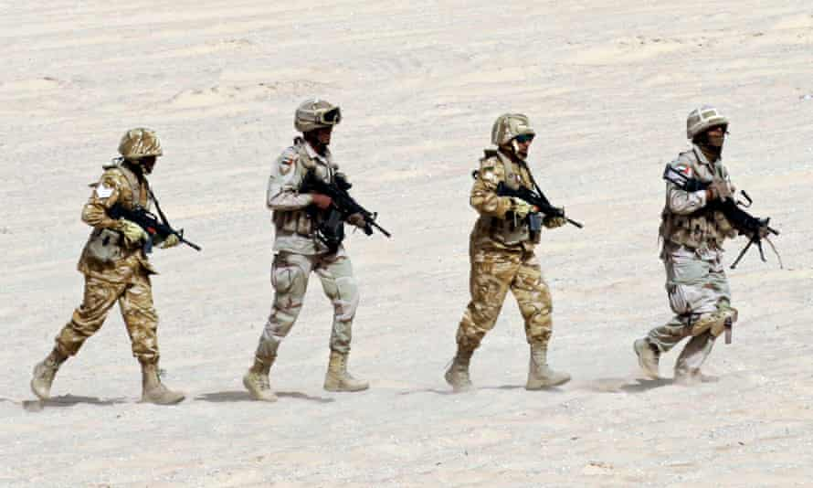 The United Arab Emirates military, seen here with troops from France and Qatar, rescued the al-Qaida hostage from Yemen.