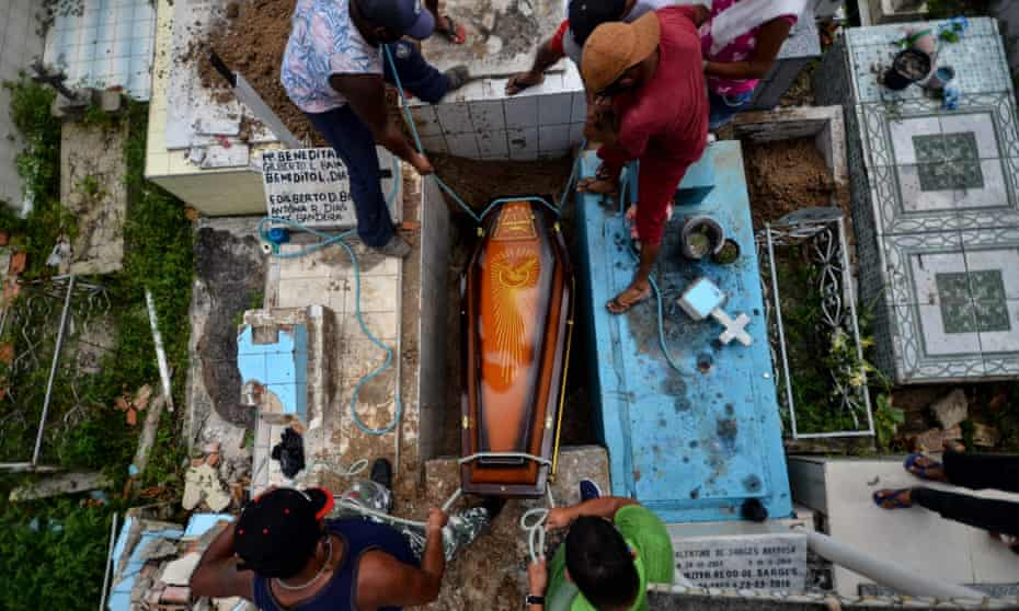 Gravediggers bury a Covid-19 victim at the municipal cemetery in Abaetetuba in Para state, Brazil on Thursday.