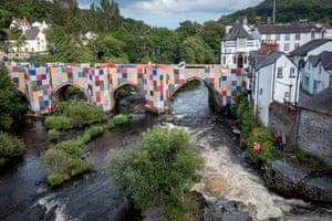 Patchwork panels cover Llangollen Bridge in Wales