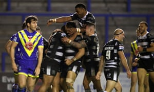 Hull celebrate Chris Satae's try, his team's third of the game, as they kept Warrington at bay in the second half.
