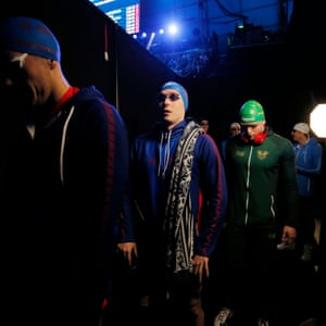 Anton Chupkov a Russian swimmer for Energy Standard team (centre) walks out in front of Great Britain's Adam Peaty of London Roar for the men's 200m breaststroke.