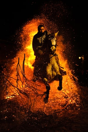 Rider and horse jump out of the bonfire