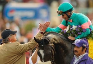 After winning the Breeders' Cup Classic horse race, jockey Mike Smith, riding Zenyatta, and trainer John Shirreffs, left, greet each othe.