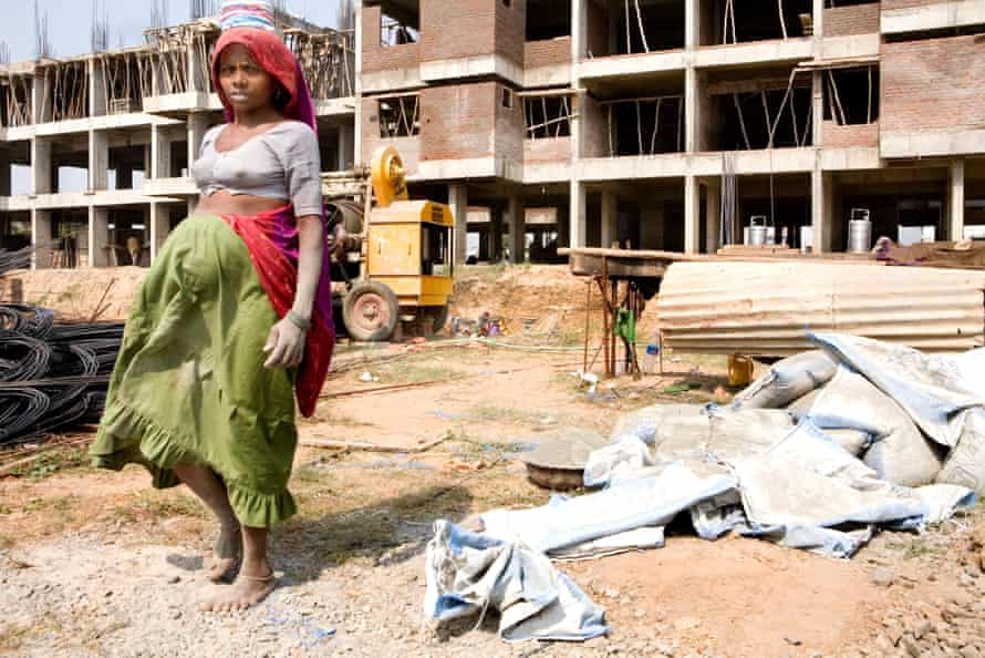 A pregnant female worker at a construction site in Ahmedabad, in India's Gujarat state